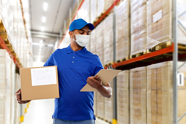 Online retail warehouse worker in safety gear